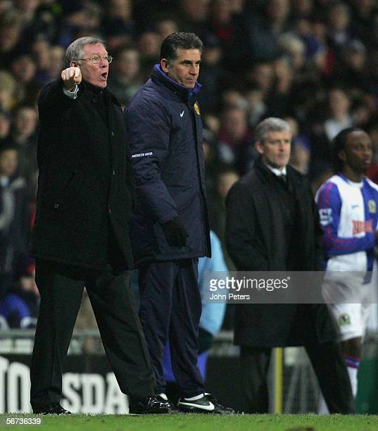 Sir Alex Ferguson and Carlos Queiroz of Manchester United and Mark Hughes of Blackburn Rovers watch from the sidelines after the Barclays Premiership...