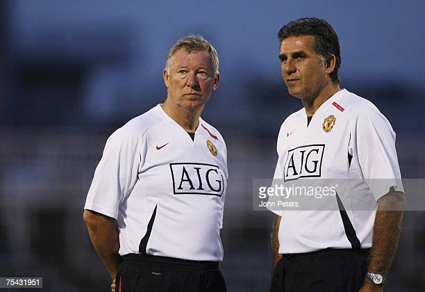 Sir Alex Ferguson and Carlos Queiroz of Manchester United in action during a First Team training session at the start of their Far East Tour at...