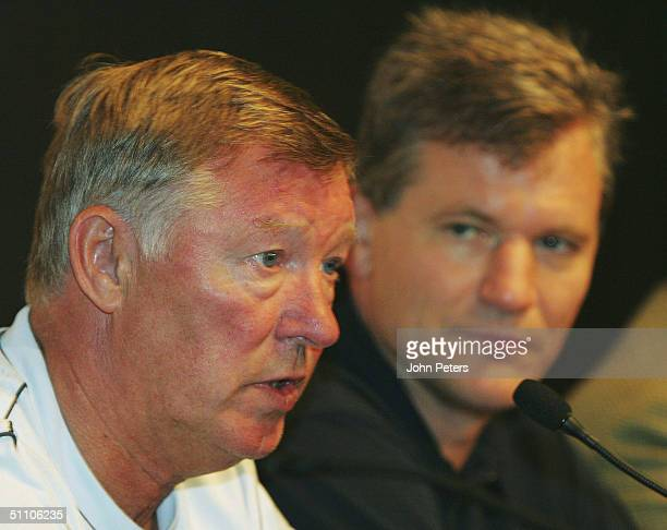 Sir Alex Ferguson and Chief Executive David Gill of Manchester United attends a press conference ahead of a training session at the start of their...