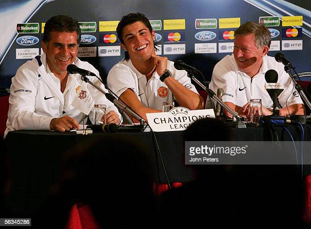 Sir Alex Ferguson and Cristiano Ronaldo laugh during the press conference at which Carlos Queiroz acted as interpreter ahead of the UEFA Champions...