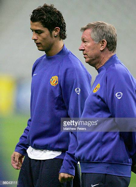 Sir Alex Ferguson and Cristiano Ronaldo of Manchester United in action during a first team training session ahead of the UEFA Champions League match...