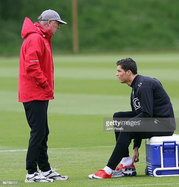 Sir Alex Ferguson and Cristiano Ronaldo of Manchester United in action during a First Team Training Session at Carrington Training Ground on May 8...