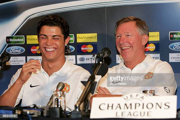 Sir Alex Ferguson and Cristiano Ronaldo of Manchester United laugh during the press conference ahead of the UEFA Champions League match between...