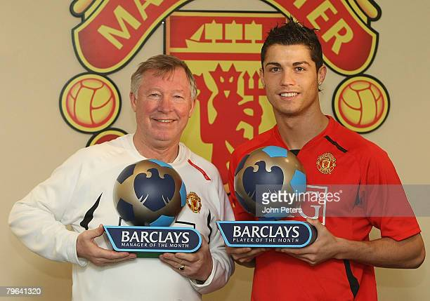 Sir Alex Ferguson and Cristiano Ronaldo of Manchester United pose with thers Barclays Manager of the Month and Player of the Month awards for January...