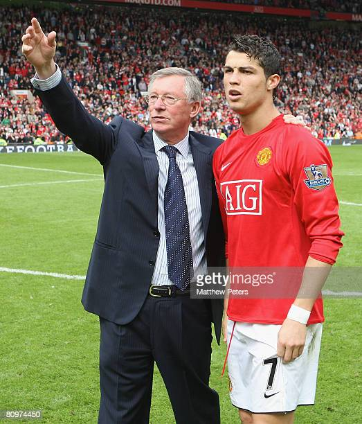 Sir Alex Ferguson and Cristiano Ronaldo of Manchester United salute the crowd after the Barclays FA Premier League match between Manchester United...