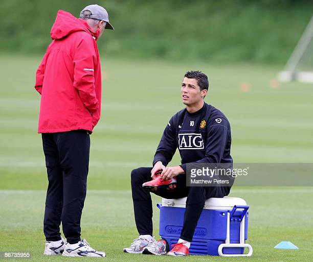 Sir Alex Ferguson and Cristiano Ronaldo of Manchester United talk during a First Team training session at Carrington Training Ground on May 8 2009 in...