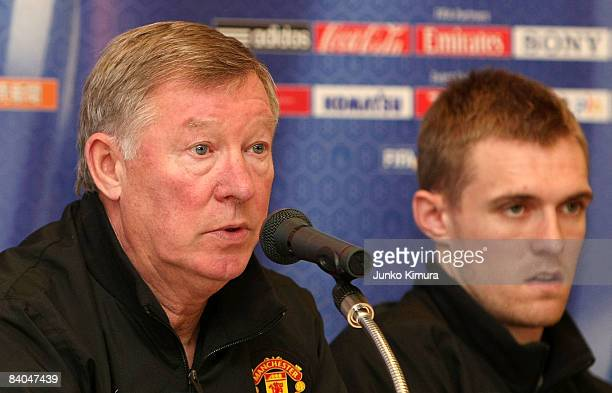 Sir Alex Ferguson and Darren Fletcher of Manchester United attends the Manchester United Team Arrival Press Conference at Pacifico Yokohama on...
