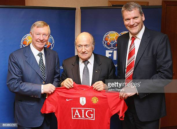 Sir Alex Ferguson and David Gill of Manchester United pose with Sepp Blatter of FIFA and a United shirt bearing the FIFA World Champions 2009 badge...