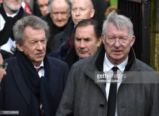 Sir Alex Ferguson and Denis Law can be seen with fellow mourners as the funeral of former Manchester United and Northern Ireland footballer Harry...
