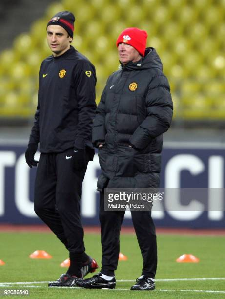 Sir Alex Ferguson and Dimitar Berbatov of Manchester United in action during a training session ahead of their UEFA Champions League match against...