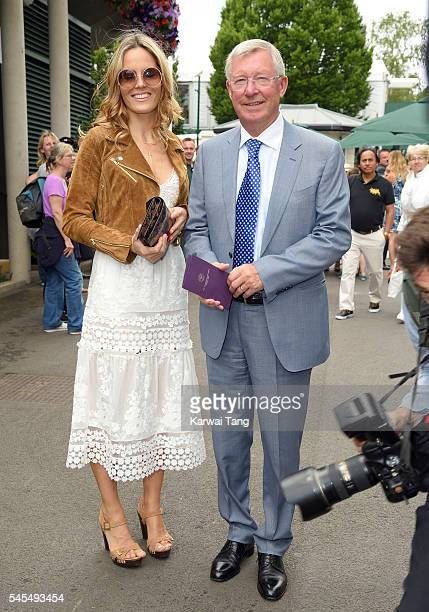 Sir Alex Ferguson and Fiona Ferguson attend day eleven of the Wimbledon Tennis Championships at Wimbledon on July 08 2016 in London England