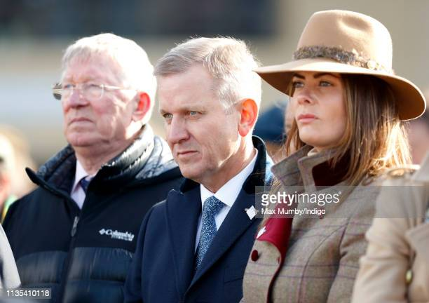Sir Alex Ferguson and Jeremy Kyle watch the racing on day 1 'Champion Day' of the Cheltenham Festival at Cheltenham Racecourse on March 12 2019 in...