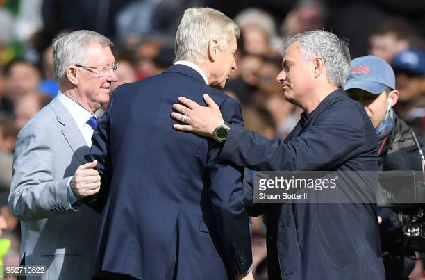 Sir Alex Ferguson and Jose Mourinho Manager of Manchester United greet Arsene Wenger Manager of Arsenal pitchside prior to the Premier League match...