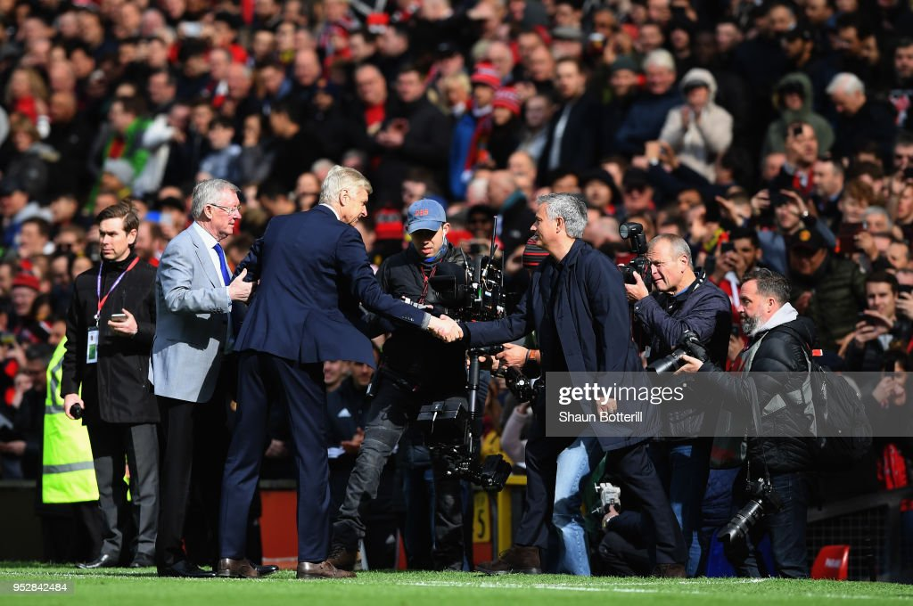Sir Alex Ferguson and Jose Mourinho, Manager of Manchester United greet Arsene Wenger, Manager of Arsenal pitchside prior to the Premier League match between Manchester United and Arsenal at Old Trafford on April 29, 2018 in Manchester, England.