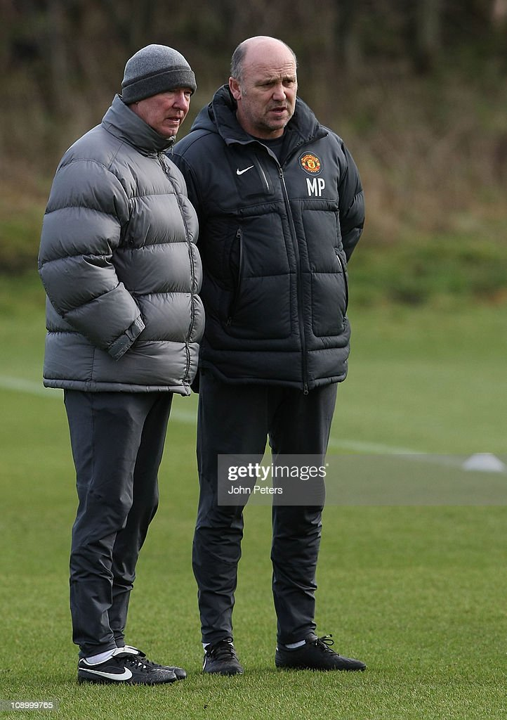 Sir Alex Ferguson (L) and Mike Phelan of Manchester United in action during a first team training session at Carrington Training Ground on February 11, 2011 in Manchester, United Kingdom.