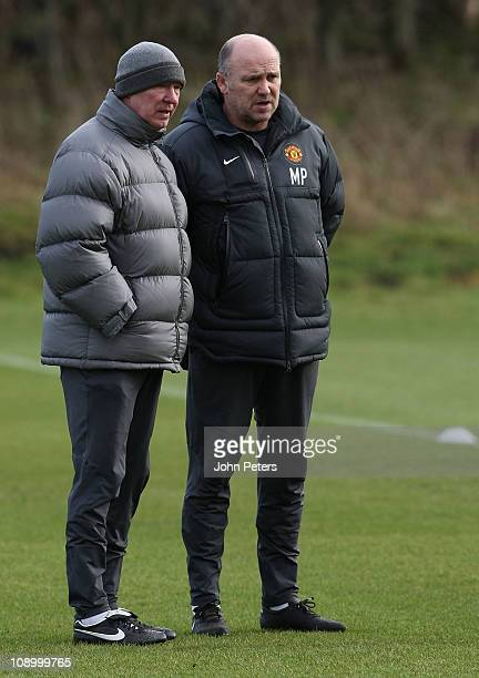 Sir Alex Ferguson and Mike Phelan of Manchester United in action during a first team training session at Carrington Training Ground on February 11...