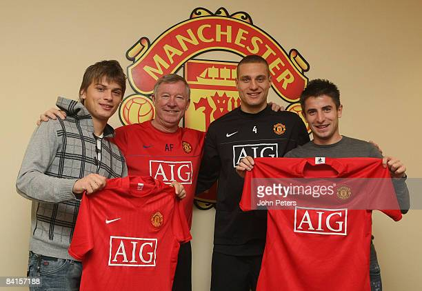 Sir Alex Ferguson and Nemanja Vidic of Manchester United pose with new Serbian signings Zoran Tosic and Adem Ljajic at Carrington Training Ground on...