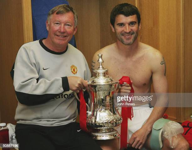 Sir Alex Ferguson and Roy Keane of Manchester United celebrate with the FA Cup in the dressing room after winning the AXA FA Cup Final between...
