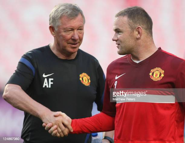 Sir Alex Ferguson and Wayne Rooney of Manchester United in action during a first team training session ahead of the UEFA Champions League Group C...