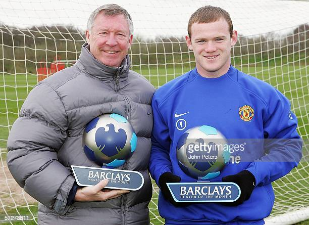 Sir Alex Ferguson and Wayne Rooney of Manchester United pose with their Barclays Manager of the Month and Barclays Player of the Month awards at...