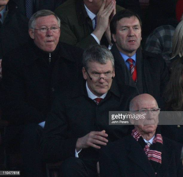 Sir Alex Ferguson David Gill and Sir Bobby Charlton of Manchester United watch from the directors box during the Barclays Premier League match...