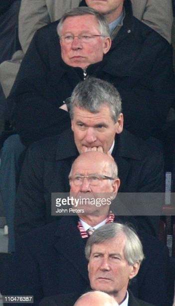 Sir Alex Ferguson, David Gill, Sir Bobby Charlton and former chairman Martin Edwards of Manchester United watch from the directors box during the...