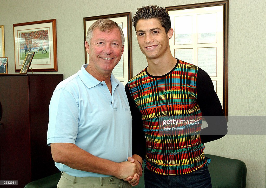 Sir Alex Ferguson greets Cristiano Ronaldo as the young Portugese player signs for Manchester united at the Carrington Training Ground, Carrington on August 12, 2003 in Manchester, England.