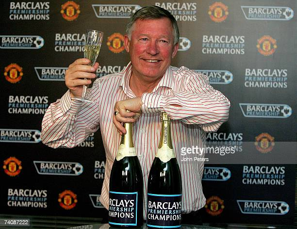 Sir Alex Ferguson holds up a glass of champagne to celebrate Manchester United winning the Premiership title on May 6 2007 in Manchester England