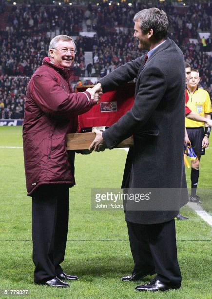 Sir Alex Ferguson is presented with a bottle of wine by Manchester United Chief Executive David Gill to mark his 1000th match in charge ahead of...
