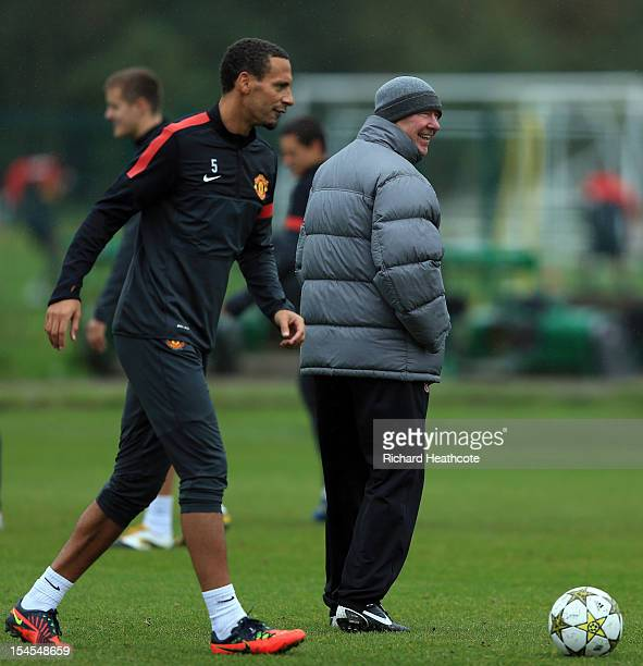 Sir Alex Ferguson jokes with Rio Ferdinand during the Manchester United Training Session ahead of their UEFA Champions League match against Braga at...