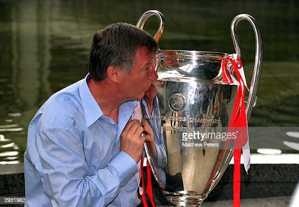 Sir Alex Ferguson kisses the European Cup the morning after the victory in the UEFA Champions League Final between Bayern Munich v Manchester United...