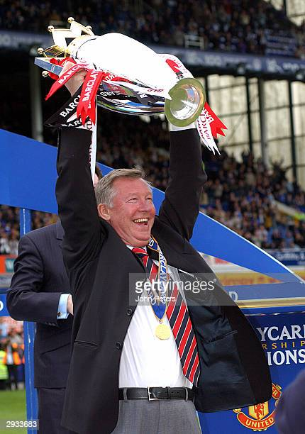 Sir Alex Ferguson lifts the Premiership Trophy after the FA Barclaycard Premiership match between Everton v Manchester United at Goodison Park on May...