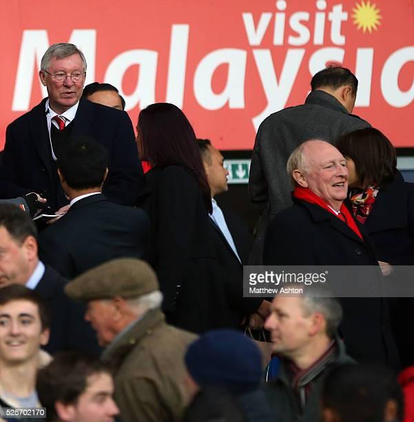 Sir Alex Ferguson looks over at Neil Kinnock