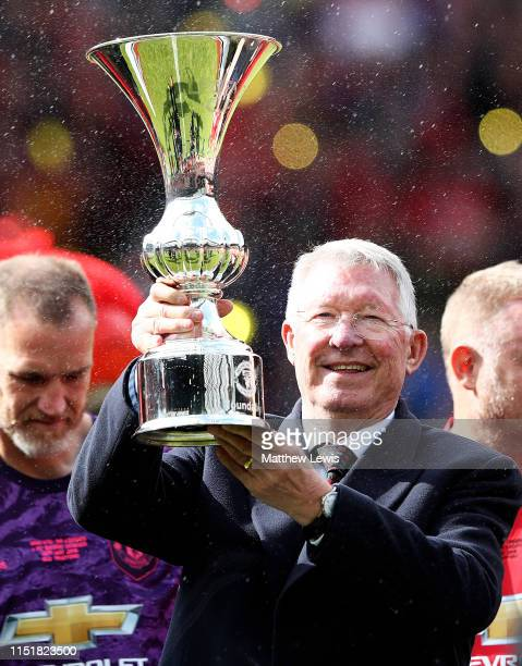 Sir Alex Ferguson manager of Manchester United '99 Legends pictured with the trophy after his team beat the FC Bayern Legends during the Manchester...