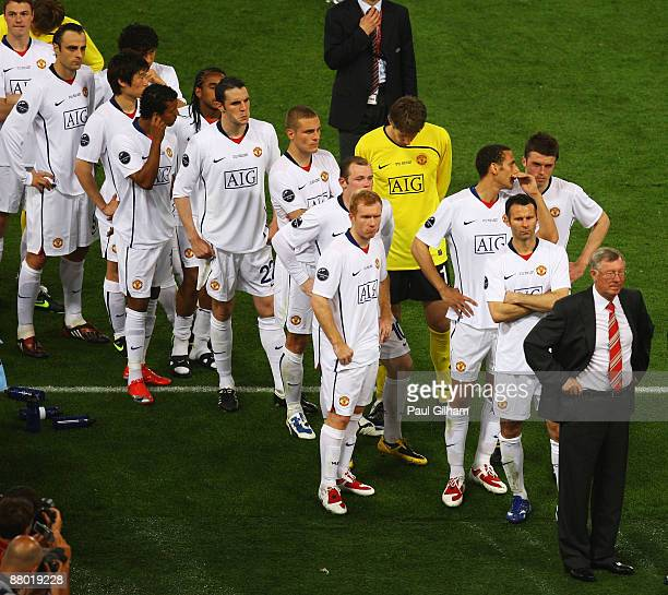 Sir Alex Ferguson manager of Manchester United and his players stand dejected after Barcelona won the UEFA Champions League Final match between...