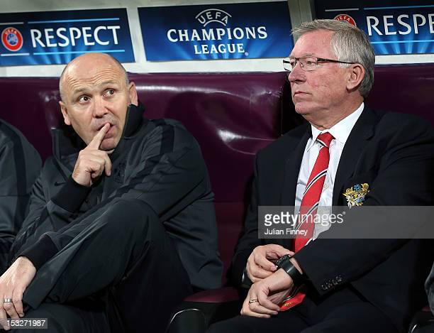Sir Alex Ferguson manager of Manchester United and Mike Phelan look on before the UEFA Champions League Group H match between CFR 1907 Cluj and...