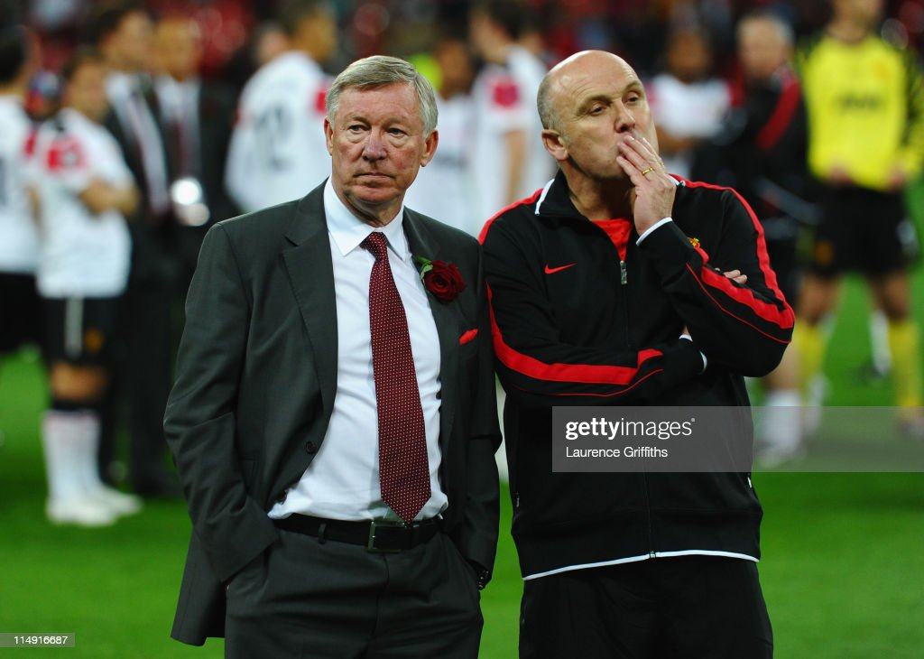 Sir Alex Ferguson manager of Manchester United (L) and Mike Phelan assistant manager of Manchester United show their dejection after the UEFA Champions League final between FC Barcelona and Manchester United FC at Wembley Stadium on May 28, 2011 in London, England.