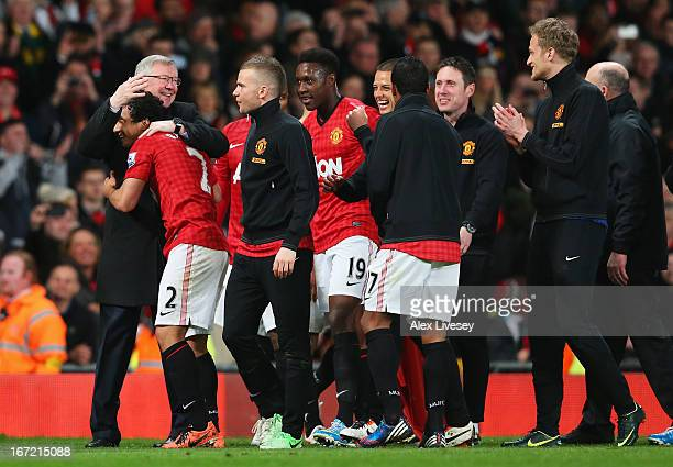 Sir Alex Ferguson manager of Manchester United celebrates victory and winning the Premier League title with Rafael after the Barclays Premier League...