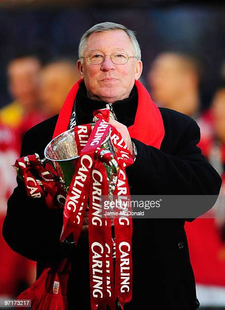 Sir Alex Ferguson manager of Manchester United celebrates with the trophy after victory in the Carling Cup Final between Aston Villa and Manchester...