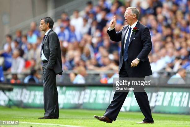 Sir Alex Ferguson manager of Manchester United gestures as Jose Mourinho manager of Chelsea looks on during the FA Cup Final match sponsored by EON...