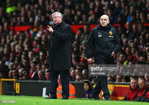 Sir Alex Ferguson manager of Manchester United gives instructions with assistant Mike Phelan during the Barclays Premier League match between...