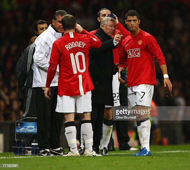 Sir Alex Ferguson manager of Manchester United gives instructions to Cristiano Ronaldo of Manchester United during the UEFA Champions League Group F...