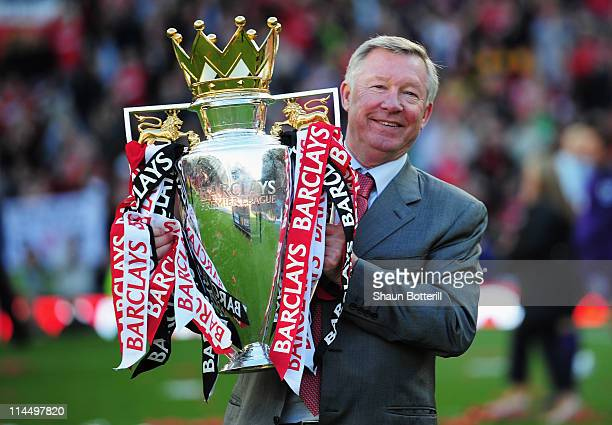 Sir Alex Ferguson manager of Manchester United lifts the Premier League trophy after the Barclays Premier League match between Manchester United and...