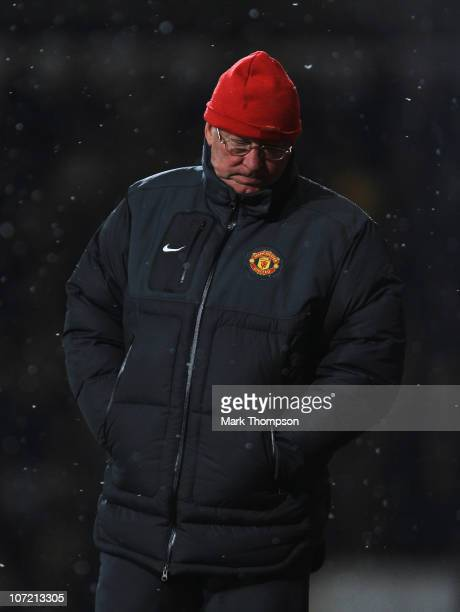 Sir Alex Ferguson manager of Manchester United looks dejected during the Carling Cup Quarter Final match between West Ham United and Manchester...