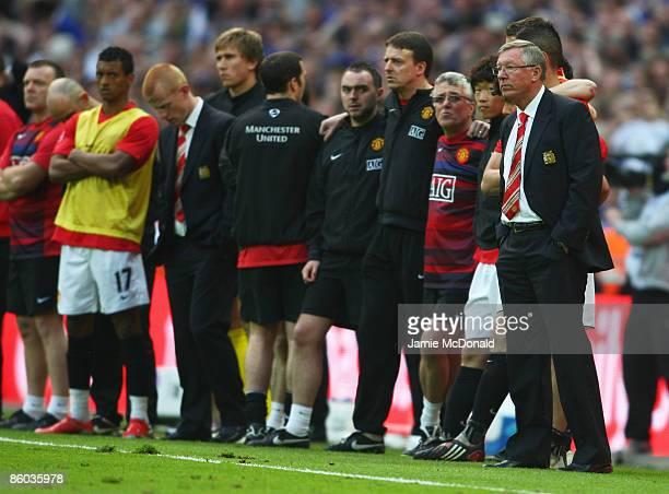 Sir Alex Ferguson manager of Manchester United looks on in the penalty shoot out during the FA Cup sponsored by EON Semi Final match between Everton...
