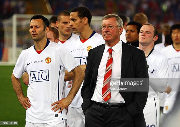 Sir Alex Ferguson manager of Manchester United stands next to his players after Barcelona won the UEFA Champions League Final match between...