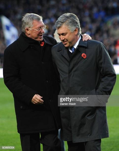 Sir Alex Ferguson Manager of Manchester United talks to Carlo Ancelotti Manager of Chelsea during the Barclays Premier League match between Chelsea...