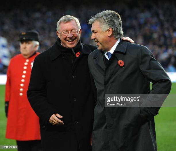 Sir Alex Ferguson Manager of Manchester United talks to Carlo Ancelotti Manager of Chelsea 3during the Barclays Premier League match between Chelsea...