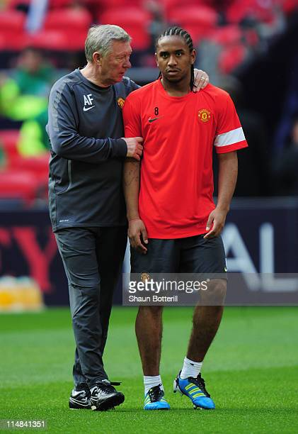 Sir Alex Ferguson manager of Manchester United talks with player Anderson of Manchester United during a Manchester United training session prior to...