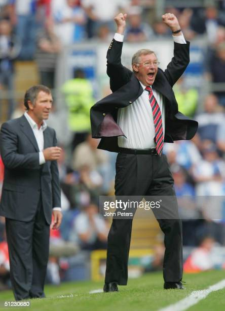Sir Alex Ferguson of Manchester United celebrates after Alan Smith scored the second goal during the Barclays Premiership match between Blackburn...